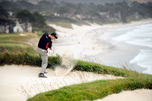 ,who won the 2003 U.S. Open at Olympia Fields, escapes from a bunker near the cliffs on the par-4 ninth. Furyk finished the tournament T16.