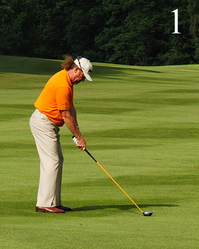 Like all Tour players, Jimenez has his weight                       over the balls of his feet and his knees over                       his toes. Pay particular attention to how his                       upper arms hang straight down, then bend                       at the elbow to set the shaft so that it                       points at his belt buckle.