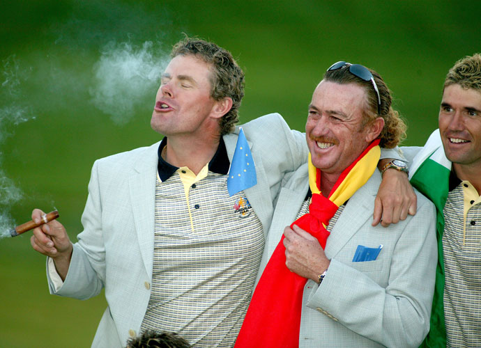 Europe's Joachim Haeggman smokes a cigar as he celebrates with Miguel Angel Jimenez and Padraig Harrington after the European team won the 2004 Ryder Cup at Oakland Hills Country Club in Michigan. The Euros had good reason to smoke a victory cigar after winning, 18-1/2 to 9-1/2.
