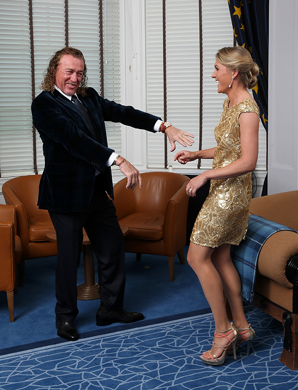 Europe team vice captain Miguel Angel Jimenez and his wife Suzanne Jimenez goof around before leaving for the Ryder Cup Gala dinner.