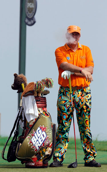 John Daly smokes a cigarette on No. 16 during a practice round for the 2010 PGA Championship at Whistling Straits in Wisconsin. The 1991 PGA Champion withdrew with a shoulder injury after shooting a 76 in the first round.