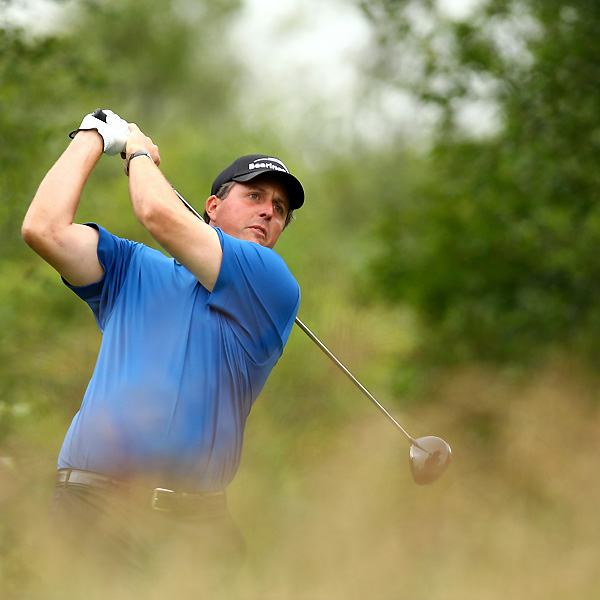 Phil Mickelson showed no signs of a nagging wrist injury on Thursday, as he opened with a six-under 65.
