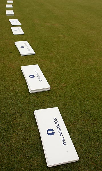 Name cards were spread out on the driving range for the field of players.