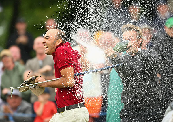 Havret, being doused here by countryman Thomas Levet, qualified for the British Open with his win at the Scottish Open.