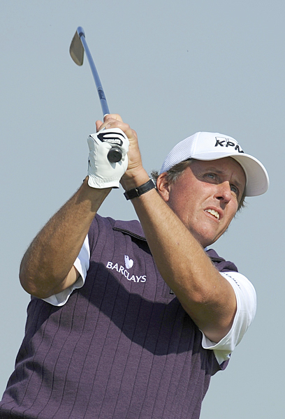 Phil Mickelson has only one top-10 at the Open, but he's three strokes back after a 69 on Friday.