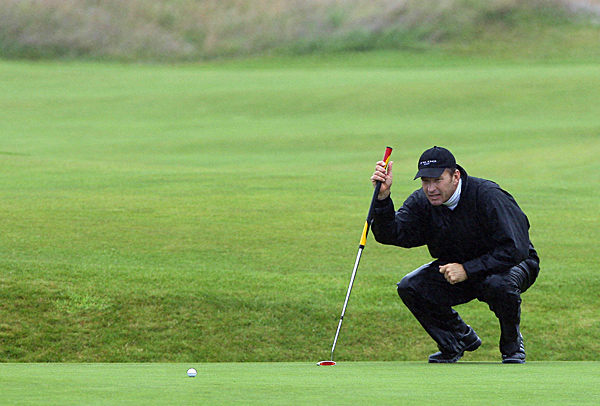 Nick Faldo, who has won three British Open Championships, played a practice round in the rain Monday.