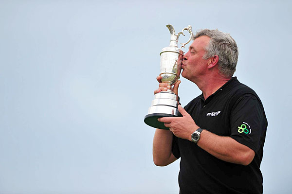 Darren Clarke held off Phil Mickelson and Dustin Johnson to win the Open by three strokes.