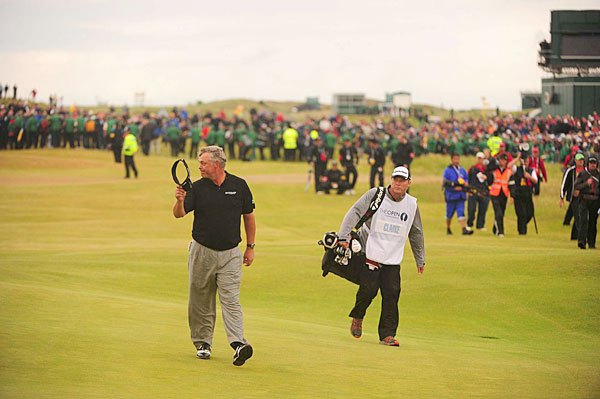 With a four-shot lead on the 72nd hole, Clarke enjoyed his walk down the 18th fairway.