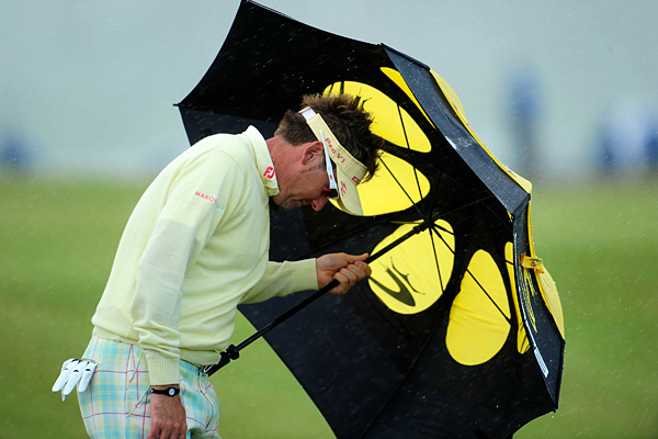 and the rest of the field continued to play through high winds and rain at the Old Course.