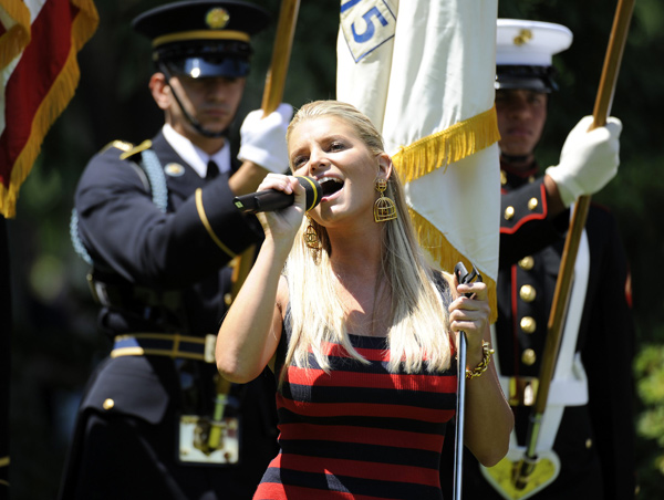 Simpson kicked off the opening ceremonies by singing the national anthem.
