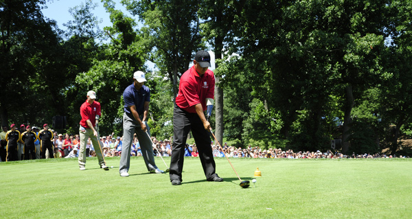 Staff Sgt. Ramon Padilla, right, and Major Ken Dwyer joined Woods to hit a ceremonial tee shot.