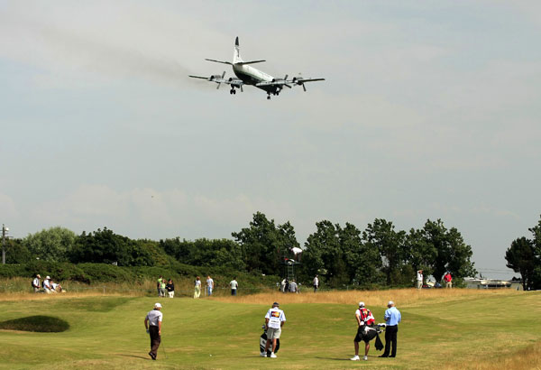 Norman waited for a plane to land prior to playing his second shot on No. 9.