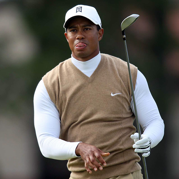 Tiger Woods had his own two-tone approach: a camel-colored Nike sweater over a tight, long-sleeved white mock turtleneck.