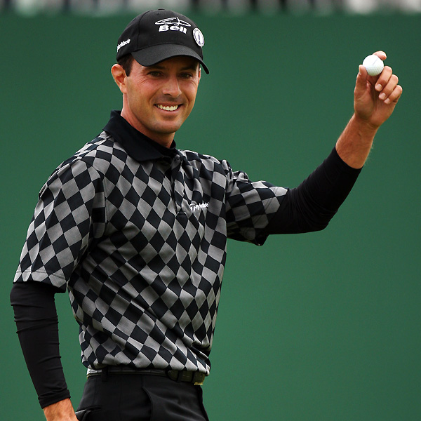 At the British Open in Carnoustie, Scotland, the drizzly, windy weather had the golfers donning their usual pullovers and sweater vests. But sweaters tend to add bulk, and as the day goes on, players got hot. Several top pros chose a new twist: pairing a light polo shirt with a long-sleeved undershirt, for insulation. The contrasting colors of the longer sleeved shirt beneath often resulted in a vivid two-tone look.                                          Mike Weir chose a black undershirt with his two-tone golf shirt.
