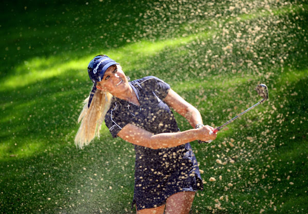 Defending champion Natalie Gulbis made a birdie on 18 to shoot even par.
