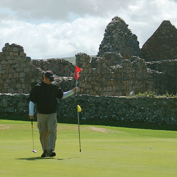 "At Ballycastle, Coyne says, ""The first five holes are a bit sleepy, plain parkland holes winding their way around the ruins of Bonamargy Abbey, circa 1500, which keeps you interested enough."" For his brother-in-law Tim, the Abbey provided a stone wall for him to play his tee shot off, ricocheting it out of the ancient graveyard and back into play."