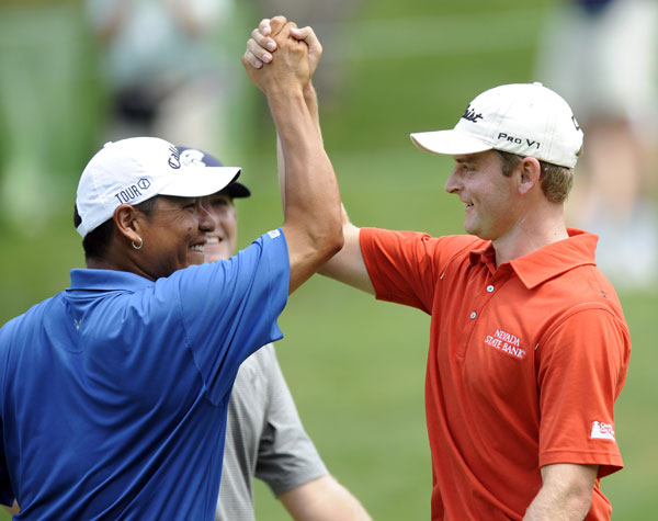 John Merrick, right, celebrated his eagle on the 18th hole with Notah Begay III.
