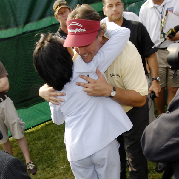 Mickelson got a hug from U.S. Secretary of State Condoleezza Rice after he finished the second round.