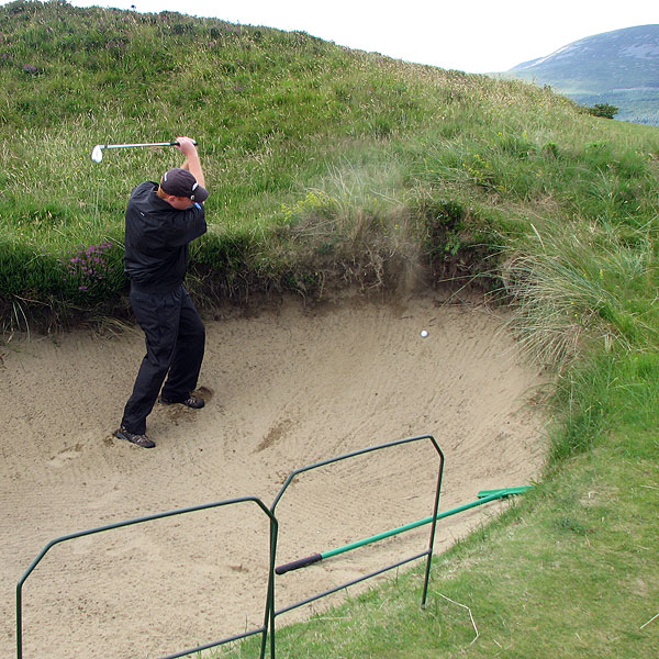 "Coyne found himself in the bunker at County Down. ""[County Down is] tough as hell, but frankly, it might be as good as golf gets,"" he said."