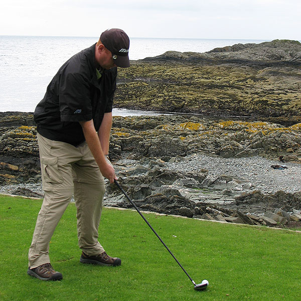 "Coyne tees off on the first hole at Ardglass. ""Ardglass was not only very playable, but the sea was in view on almost every hole, a trait I've found uncommon,"" he said."
