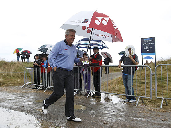 Colin Montgomerie left the driving range after it started to rain again.