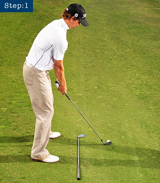 TRY THIS ALIGNMENT AND SWING-PATH DRILL                       STEP 1                       Get square by setting a club parallel to your target line and your feet parallel to the club.