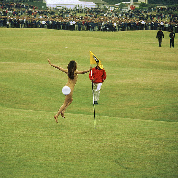 2000 British Open at St. Andrews: This female streaker took a turn around the flag stick at St. Andrews during the 2000 British Open as Tiger Woods's group made their way to the green.