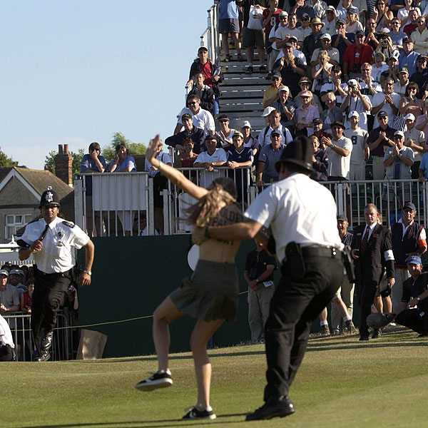 2003 British Open at Royal St. George: At the 2003 British Open, this streaker waited until the trophy presentation to strut her stuff on the course, with that year's champion Ben Curtis looking on.