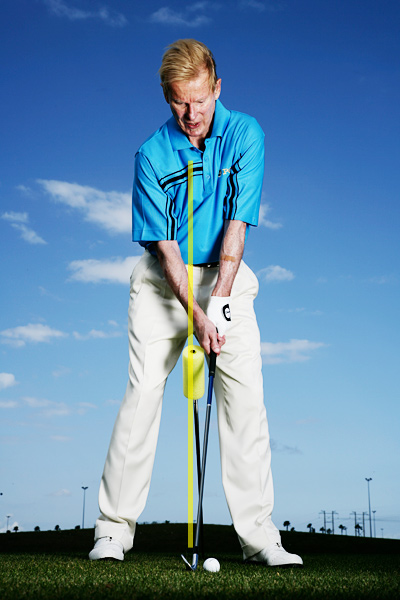 How to be a Consistent Ballstriker                      Drive your right knee to unlock the secret power in your swing                                           By T.J. Tomasi, Ph.D.                      Top 100 Teacher                     This story is for you if...                                          • You make contact all over the clubface, but rarely in the center.                                          • You tend to slide your hips rather than turn them on your downswing.                                          Try this!                                          STICK a shaft or dowel into the ground at a 45-degree angle (I've added a yellow foam pad to better illustrate the drill in this lesson), and take your stance over the shaft as shown. Set your feet so that the shaft bisects the middle of your body. Now make your swing.