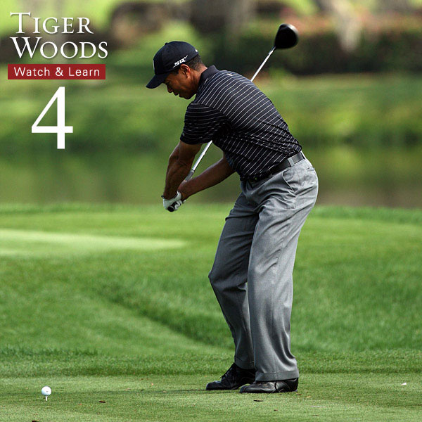 Tiger's hips are more open than his shoulders, but here's where they slow down. This is a great move to copy. As you approach impact, slow down your lower body so your arms can release properly.