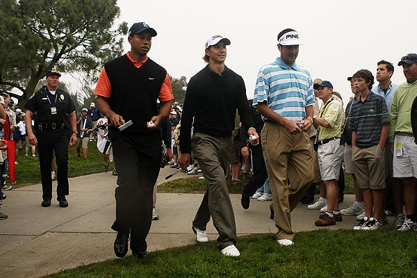 Woods played with amateur Jordan Cox, center, and Bubba Watson.