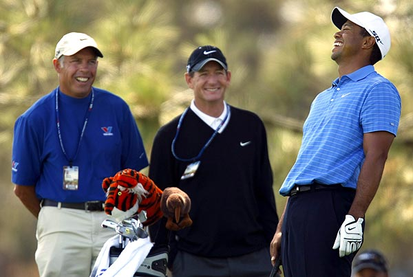 Woods seemed relaxed during his practice session as his caddie, Steve Williams, left, and his coach, Hank Haney, looked on.