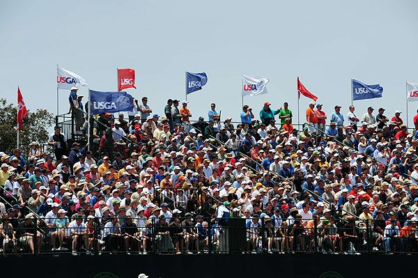 Woods, Mickelson and Scott were followed by a large crowd all day.