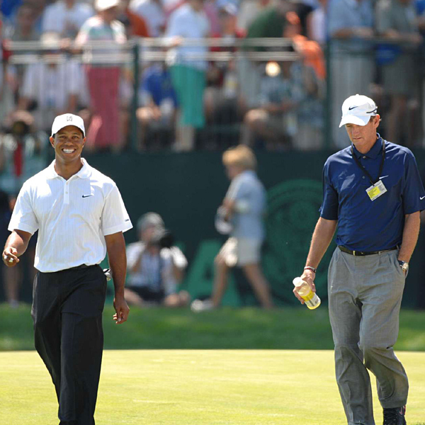 Woods walked the course with his coach, Hank Haney.
