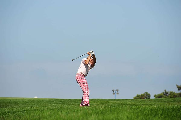 Poulter's drive found the right rough, where he tried to chop it out.