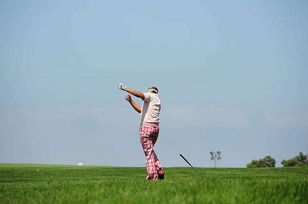 His second shot only traveled a few feet. In frustration, Poulter tossed his club into the thick grass.
