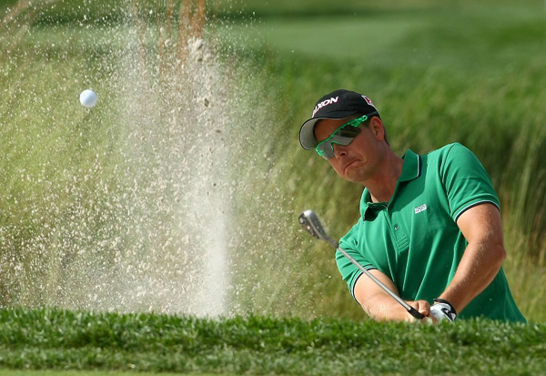 Players champion Henrik Stenson wore sunglasses to match his shirt.