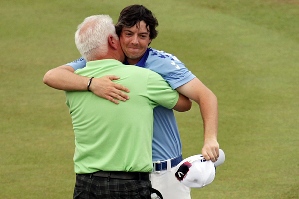 McIlroy's father, Gerry, rushed out to greet his son after he finished. McIlroy simply wished him a happy Father's Day.