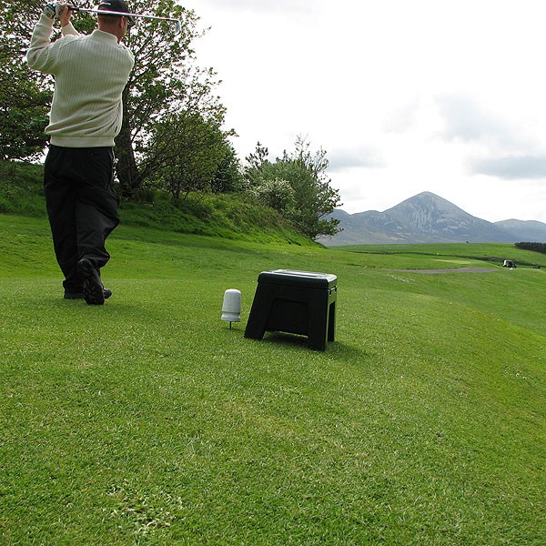 Tom Coyne takes a shot on No. 14 at Westport toward the famous mountain, Croagh Patrick, seen in the background.                                                                      Course Called Ireland: The Luckiest Suffering Golfer in the World