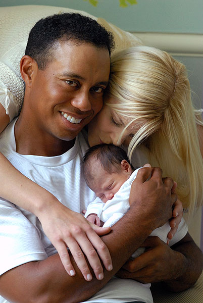 Tiger Woods at home with Elin and their new daughter, Sam Alexis                       , who was born in June of 2007.