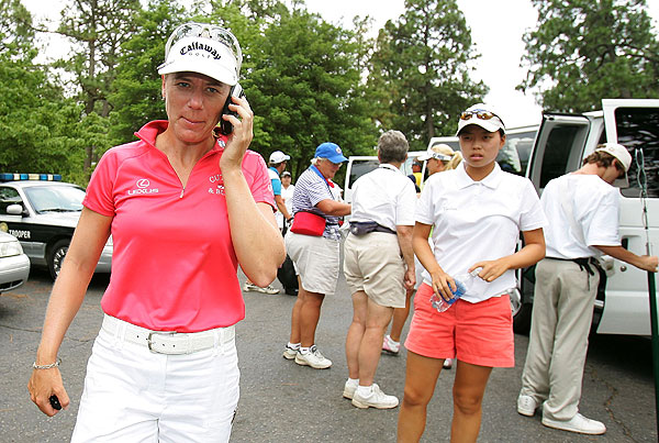 Annika Sorenstam exited an evacuation van after first-round play was suspended due to weather.