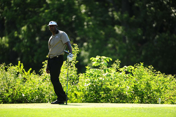 Vijay Singh double bogeyed 18 to miss the cut.