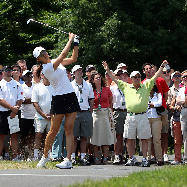 Amid controversy, Michelle Wie finished the first round of the McDonald's LPGA Championship at one over par, tied for 47th. She was three over through her first 10 holes on Friday.