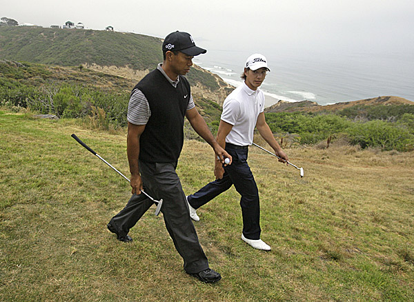 Woods and 20-year-old amateur Jordan Cox walked along the cliff between the third and fourth holes. Cox plays for Stanford, where Woods also played his college golf.
