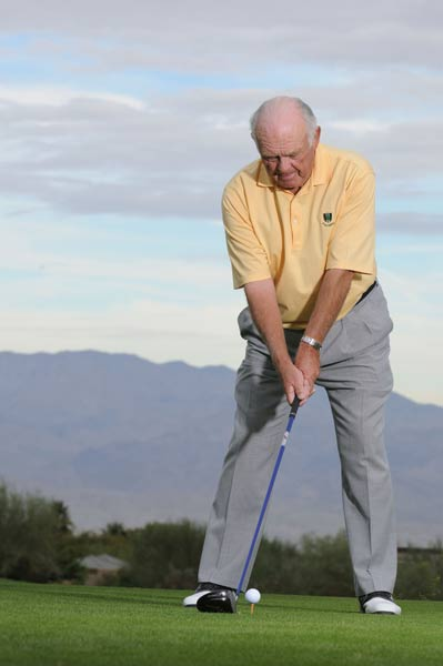 TO HIT A DRAW: Step forward and out with your left foot. Notice how this move positions the ball back between the center of your chest and your right foot and naturally tilts your spine to the right. With the ball teed here you're forced to make a more in-to-out downswing, which automatically puts right-to-left sidespin on the ball. Try to swing out at the right side of the fairway.