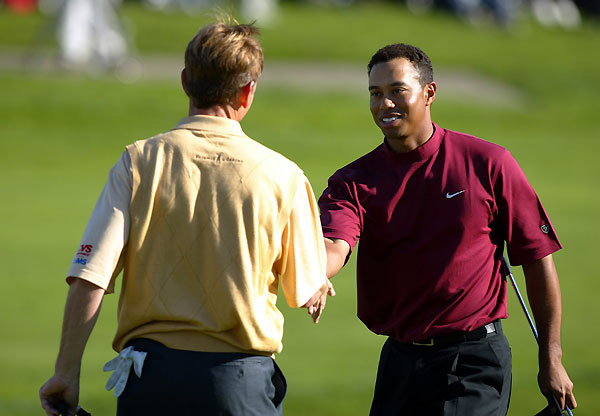 "Win 3: A Leg Up                                              Three months after surgery on his left knee, Tiger beat Carl Pettersson by four shots and Brad Faxon by five at the '03 Buick.                                              BRAD FAXON: ""Tiger had just come back from knee surgery, and Sunday was the first he and Phil had been paired together since Phil made the comment that Tiger wasn't using good equipment. I was like the referee — I was in second, Phil was third. It was absolute mayhem on the first tee with the camera people — it seemed like there were more people inside the ropes than outside. Tiger put on a clinic. It was just great shot after great shot. On the 11th hole, the par-3, the pin was in the top-left portion of the green and he hit a 4-iron, the purest, most beautiful shot. My caddie actually grunted when he hit it. Kind of like, holy cow! The ball never left its target and ended up a foot from the hole."""
