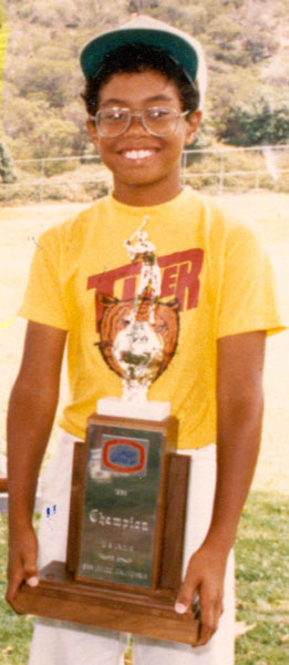 "Win 1: Teeny Bopper                                              In '91 Woods, 15, shot 74-70-73-69 to beat Chris Riley by three strokes in the 15-17-year-olds division. It was his first victory at Torrey Pines.                                              CHRIS RILEY: ""I was 17. He was 15. I remember him being really long at that age, 20, 30 yards longer than me. I had a one-shot lead going into the 12th hole and hit a good drive, and he hit a good drive. I had a 3-wood in, and he had a 7-iron! I knew he was pretty special.""                                              TIGER WOODS: ""I kicked Riley's butt, are you kidding me? [Smiles] It was me and Riley in the last group. I was one or two back...starting the last day. Tied him at 12. Funniest thing happened on 15. I hit my drive down there. He hit his drive. I'm away, I hit my wedge, and...you think Riley plays fast now?! My ball is in the air still climbing, and you hear [the sound of Riley's swing] 'fwoooop.' That's how it was. We got to 16, the par-3, and I hit my putt up there, and I said, 'I'll finish out.' The next thing you know, I'm over the putt tapping out, and I hear 'click' [as Riley hits his own putt]. I tap it in and pull it out of the hole real quick. That was a fun day."""