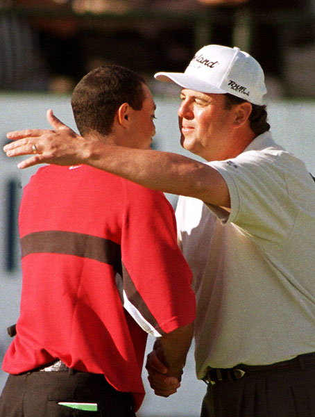 "Win 2: His Buick Ride                                              At the '99 Buick, Woods made the cut by only two, then, after a Saturday 62, held off Billy Ray Brown with a 15-foot eagle putt on the par-5 18th for a final-round 65.                                              BILLY RAY BROWN: ""[Before Torrey] I'd actually first played with him in '93, at the Nelson. I was defending champion, and Tiger had won the U.S. Junior and was playing in the Nelson pro-am. The first hole at the Nelson is a par-4. No one hits driver. He comes to me and goes, 'Mind if I come back here and play with you?,' instead of with the other amateurs. I said, 'Sure.' He reaches in his little bag, pulls out driver and just rips this thing down the right side, right in front of the green. Now, I'm the defending champion. It's supposed to be my day, and this kid [Woods was 17] has forced me to do something I didn't want to do: hit driver. I missed way, way right.                                              ""Fast-forward to '99. Tiger and I separated from the field, and it became like match play. Really fun. We laughed all day. Tiger will stare you down like Ray Floyd, and when I made birdie at 16 I stared at him, and he stared at me, and we just cracked up. He loves that stuff. He was in the cabbage on 17 and I thought I had him. But he hits this miraculous shot, and a clump of grass comes out — you could sod half a football field with it — and he gets up and down. We go to 18 dead tied. I rip a good drive. Then Tiger hits, and his drive sounds like a cannon exploding. He hits it 90 yards past me! He has so much extra in the tank. He was close to the green, which forced me to play a hook. I hit it so fat — I hit the big ball before the little ball. I made par, and his eagle putt went in like a rat diving into a hole, as his putts always seem to do. Incredible."""