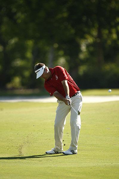 Perry is three strokes behind early leader Charles Wi.