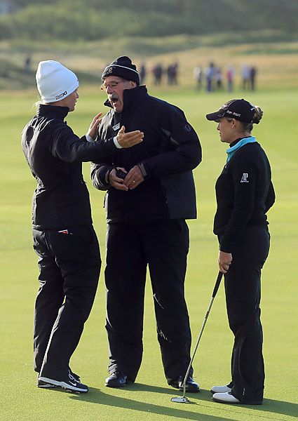 With the wind moving their balls on the green, Kerr and Suzann Pettersen pleaded their case to a rules official. Play was eventually canceled.